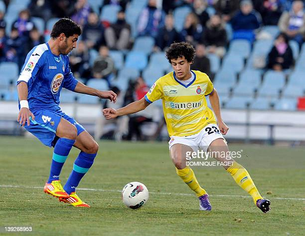 Getafe's defender Miguel Torres vies for the ball with Espanyol's Argentinian midfielder Jesus Datolo during the Spanish league football match Getafe...