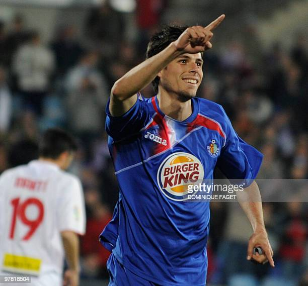 Getafe's forward Manu del Moral reacts after scoring a goal during a Spanish league football match Getafe/Mallorca at the Alfonso Perez Coliseum in...
