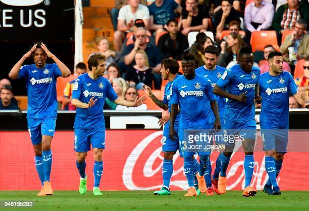 Getafe's French forward Loic Remy celebrates with teammates after scoring during the Spanish league football match Valencia CF against Getafe CF at...