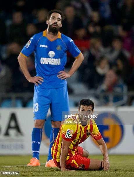 Getafe's goalkeeper Jordi Codina looks on as Barcelona's forward Pedro Rodriguez sits on the ground during the Spanish league football match Getafe...
