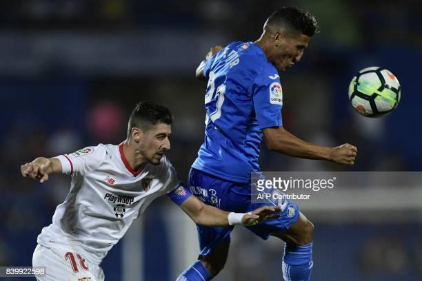 Getafe's Moroccan forward Faycal Fajr vies with Sevilla's defender Sergio Escudero during the Spanish league football match Getafe CF vs Sevilla FC...