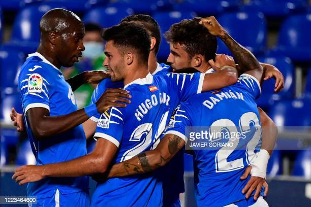 Getafe´s players celebrate after Getafe's Spanish forward Jaime Mata scored during the Spanish League football match between Getafe and Real Sociedad...