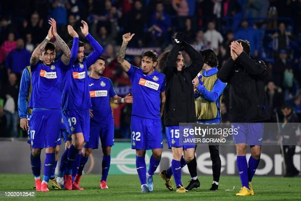 Getafe's players celebrate after the Europa League round of 32 football match between Getafe CF and Ajax Amsterdam at the Coliseum Alfonso Perez...