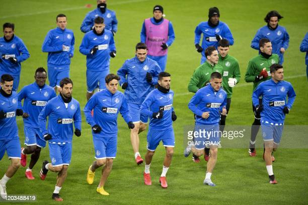 Getafe's players take prt in a training session on February 26 in Amsterdam on the eve on their UEFA Europa League round of 32 secondleg football...