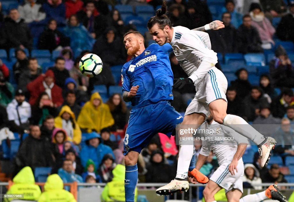 Getafe's Portuguese defender Vitorino Antunes (L) vies with Real Madrid's Welsh forward Gareth Bale during the Spanish league football match Real Madrid CF against Getafe CF at the Santiago Bernabeu stadium in Madrid on March 3, 2018. /