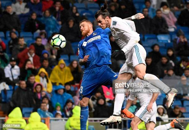 Getafe's Portuguese defender Vitorino Antunes vies with Real Madrid's Welsh forward Gareth Bale during the Spanish league football match Real Madrid...