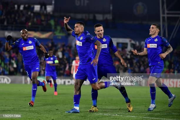 Getafe's Portuguese midfielder Kenedy celebrates after scoring during the Europa League round of 32 football match between Getafe CF and Ajax...