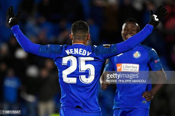 Getafe's Portuguese midfielder Kenedy celebrates his team's third goal during the UEFA Europa League Group C football match between Getafe CF and FC...