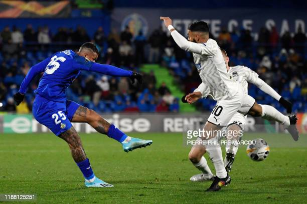 Getafe's Portuguese midfielder Kenedy shoots to score his team's third goal during the UEFA Europa League Group C football match between Getafe CF...