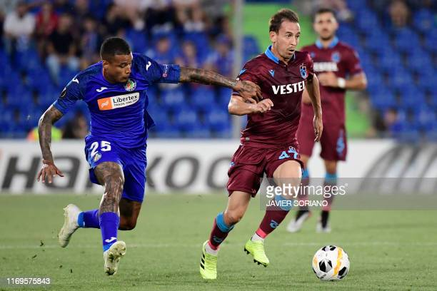 Getafe's Portuguese midfielder Kenedy vies with Trabzonspor's Portuguese defender Joao Pereira during the UEFA Europa League group C match Getafe...