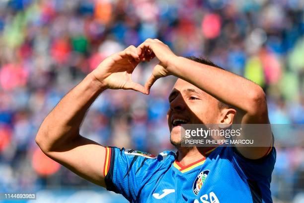 Getafe's Serbian midfielder Nemanja Maksimovic celebrates after scoring during the Spanish League football match between Getafe and Villarreal at the...