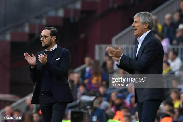 Getafe's Spanish coach Jose Bordalas L9 and Barcelona's Spanish coach Quique Setien applaud during the Spanish league football match between FC...