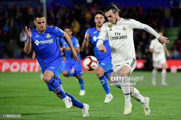 TOPSHOT Getafe's Spanish defender Bruno Gonzalez vies with Real Madrid's Welsh forward Gareth Bale during the Spanish league football match between...