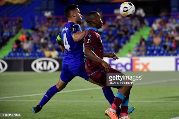 Getafe's Spanish defender Bruno vies with Trabzonspor's English forward Daniel Sturridge during the UEFA Europa League group C match Getafe against...