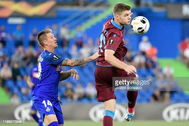 Getafe's Spanish defender Raul Garcia vies with Trabzonspor's Norwegian forward Alexander Sorloth during the UEFA Europa League group C match Getafe...