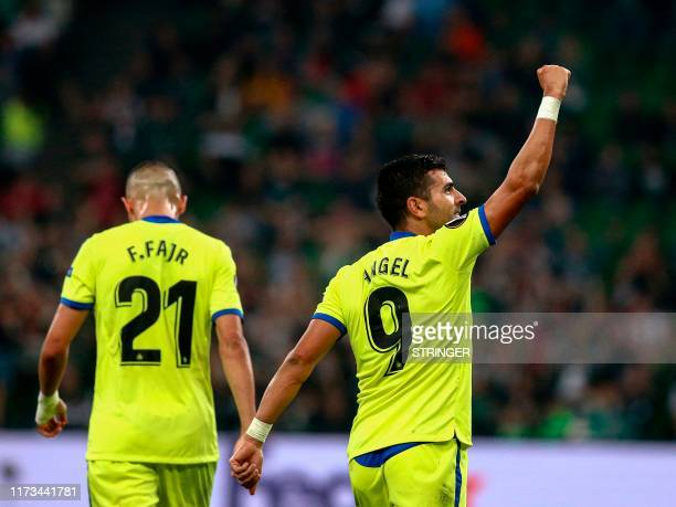 Getafe's Spanish forward Angel Rodriguez celebrates after scoring a goal during the UEFA Europa League group C football match between FK Krasnodar...