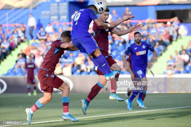 Getafe's Spanish forward Angel Rodriguez heads the ball to score the opening goal during the UEFA Europa League group C match Getafe against...
