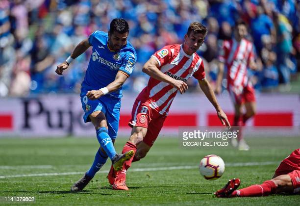 Getafe's Spanish forward Angel shoots to score a goal during the Spanish league football match between Getafe CF and Girona FC at the Col Alfonso...
