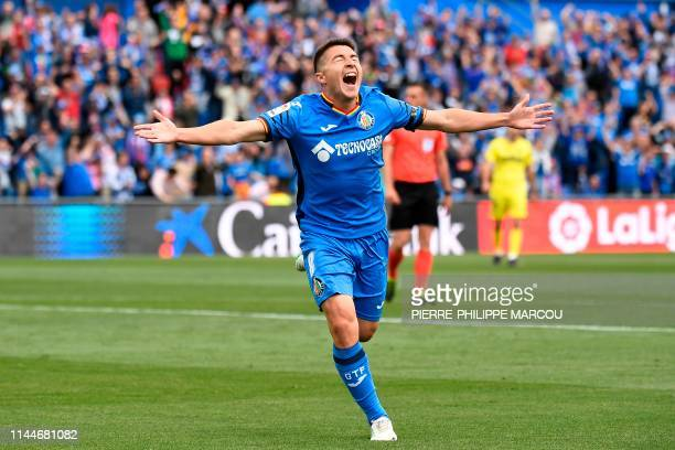 TOPSHOT Getafe's Spanish forward Francisco Portillo celebrates after scoring during the Spanish League football match between Getafe and Villarreal...