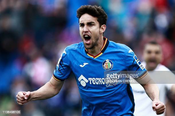 Getafe's Spanish forward Jaime Mata celebrates after his team scored a third goal during the Spanish League football match between Getafe and Sevilla...