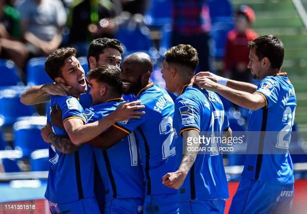 Getafe's Spanish forward Jorge Molina celebrates a goal with teammates during the Spanish league football match between Getafe CF and Girona FC at...