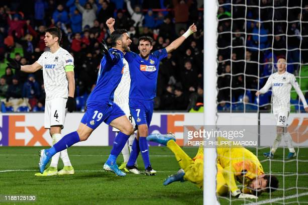 Getafe's Spanish forward Jorge Molina celebrates scoring his team's second goal during the UEFA Europa League Group C football match between Getafe...