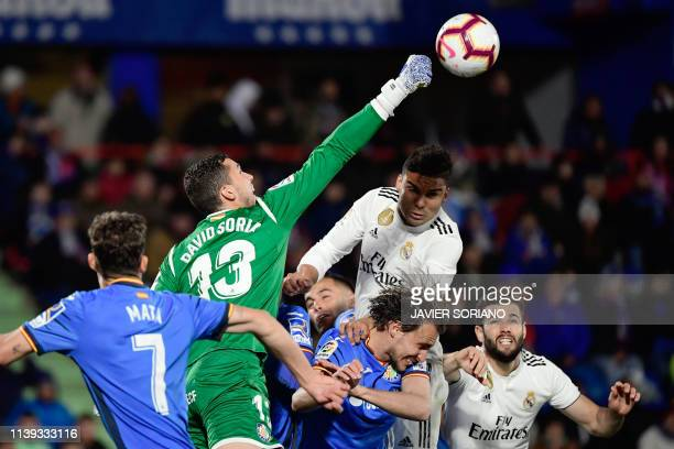 TOPSHOT Getafe's Spanish goalkeeper David Soria clears the ball during the Spanish league football match between Getafe CF and Real Madrid CF at the...