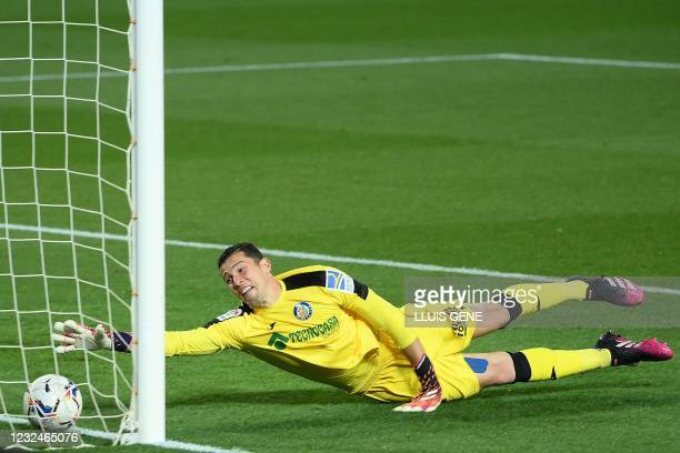 Getafe's Spanish goalkeeper David Soria fails to stop an own goal during the Spanish League football match between Barcelona and Getafe at the Camp...