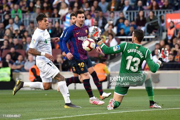 Getafe's Spanish goalkeeper David Soria stops a shot on goal by Barcelona's Argentinian forward Lionel Messi during the Spanish League football match...