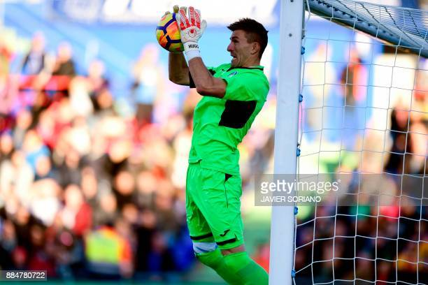 Getafe's Spanish goalkeeper Vicente Guaita grabs the ball during the Spanish league football match Getafe CF vs Valencia CF at the Col Alfonso Perez...