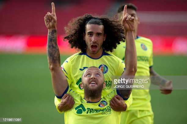 Getafe's Spanish midfielder David Timor celebrates his goal with Spanish midfielder Marc Cucurella during the Spanish League football match between...
