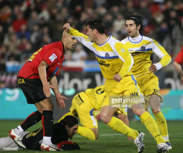 Getafe's Tena and De la Red celebrate after scoring against Mallorca during a King's Cup football match at the Ono stadium in Palma de Mallorca, 30...