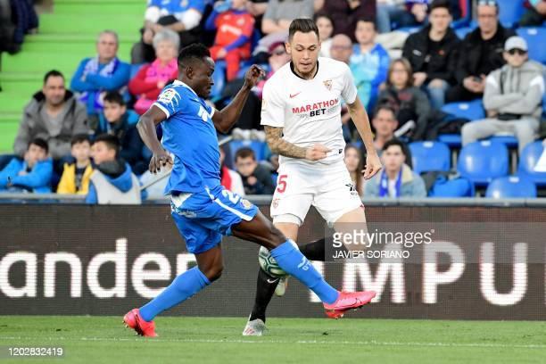 Getafe's Togolese defender Djene challenges Sevilla's Argentinian midfielder Lucas Ocampos during the Spanish league football match Getafe CF against...