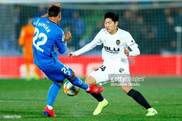 Getafe's Uruguayan defender Damian Suarez vies for the ball with Valencia's South Korean forward Lee Kangin during the Spanish Copa del Rey...