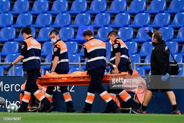 Getafe's Uruguayan defender Erick Cabaco is carried out of the pitch on a stretcher after suffering an injury during the Spanish league football...