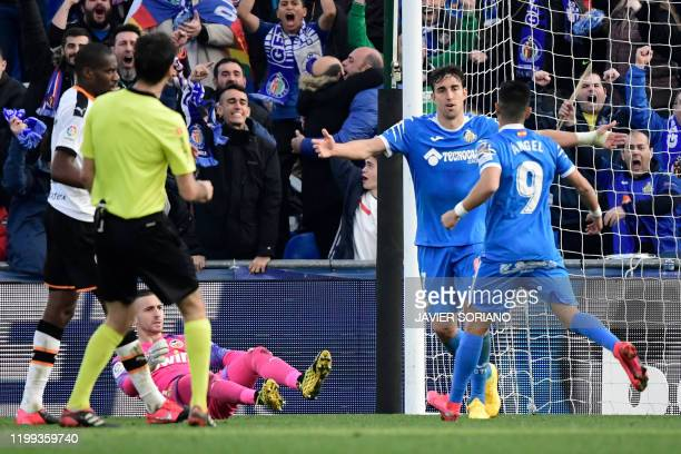 Getafe's Uruguayan defender Mathias Oliveira celebrates his goal during the Spanish league football match between Getafe CF and Valencia CF at the...