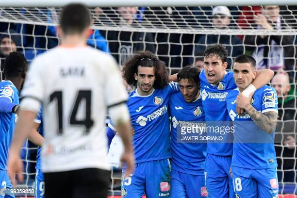 Getafe's Uruguayan defender Mathias Oliveira celebrates with teammates scoring his team's third goal during the Spanish league football match between...