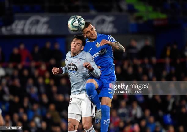 Getafe's Uruguayan midfielder Mauro Arambarri challenges Celta de Vigo´s Spanish forward Santi Mina during the Spanish league football match between...