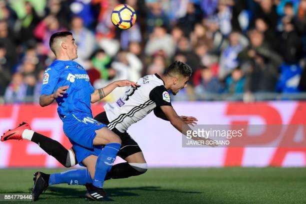 Getafe's Uruguayan midfielder Mauro Arambarri challenges Valencia's Brazilian forward Andreas Pereira during the Spanish league football match Getafe...