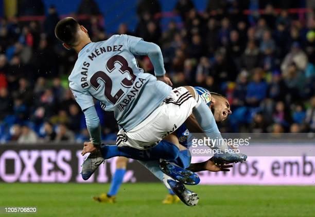 Getafe's Uruguayan midfielder Mauro Arambarri collides with Celta Vigo's Spanish midfielder Brais Mendez during the Spanish league football match...