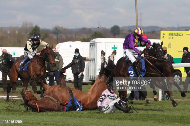 Getaway Trump and Harry Cobden fall during the Close Brothers Red Rum Handicap Chase on the first day of the Grand National Festival at Aintree...