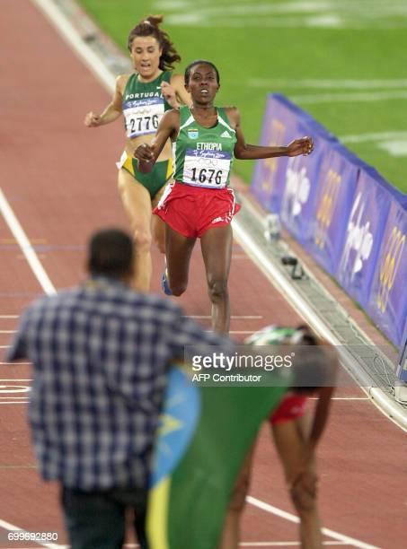 Gete Wami of Ethiopia has Fernanda Ribeiro of Portugal on her heels as she crosses the finish line second behind compatriot Derartu Tulu catching her...