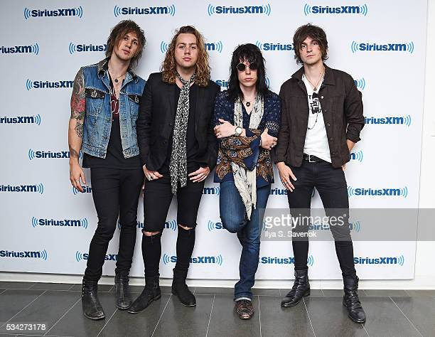 Gethin Davies Adam Slack Luke Spiller and Jed Elliott of the band The Struts visit the SiriusXM Studio on May 25 2016 in New York City