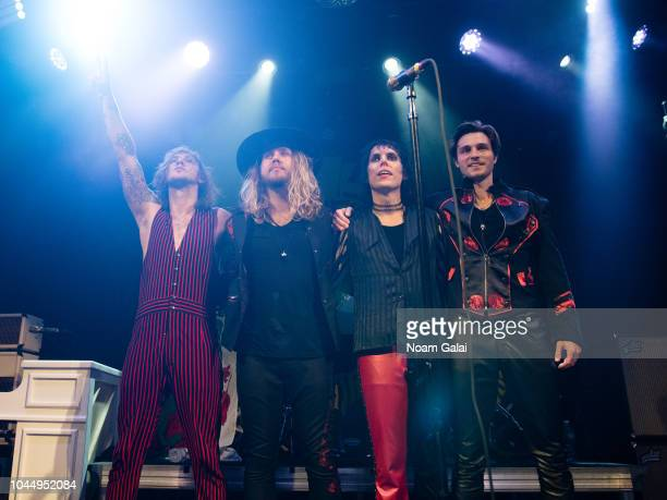 Gethin Davies Adam Slack Luke Spiller and Jed Elliott of The Struts perform in concert at Bowery Ballroom on October 2 2018 in New York City
