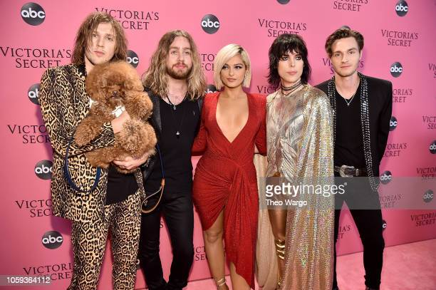Gethin Davies Adam Slack Luke Spiller and Jed Elliott of The Struts and Bebe Rexha attend the Victoria's Secret Fashion Show at Pier 94 on November 8...