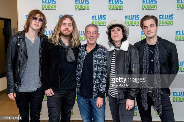 Gethin Davies Luke Spiller Adam Slack and Jed Elliott of The Struts with host Elvis Duran as they visit the Elvis Duran show at Z100 Studio on...