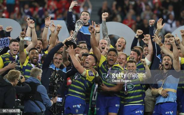 Gethin Jenkins and Ellis Jenkins of Cardiff Blues lift the trophy after winning the European Rugby Challenge Cup Final match between Cardiff Blues...