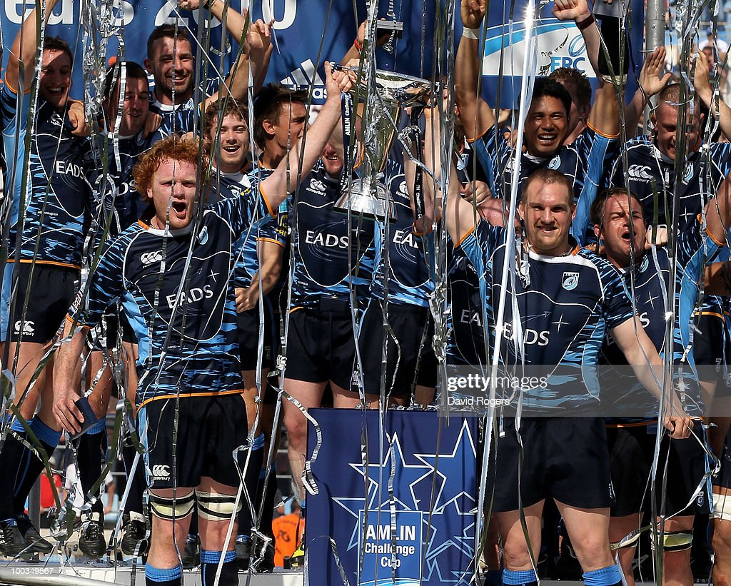 Gethin Jenkins (R), the Cardiff captain races the trophy with Paul Tito as their team celebrate victory during the Amlin Challenge Cup Final between Toulon and Cardiff Blues at Stade Velodrome on May 23, 2010 in Marseille, France.
