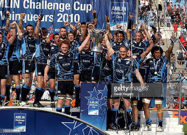 Gethin Jenkins the Cardiff captain raises the trophy with Paul Tito as their team celebrate victory during the Amlin Challenge Cup Final between...