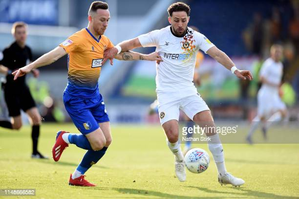 Gethin Jones of Mansfield Town and Robbie Willmott of Newport County in action during the Sky Bet League Two Playoff Semi Final Second Leg match...